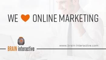 """Eine Werbeanzeige für die Online-Agentur BRAIN-interactive. Auf ihr ist der Text """"We love Online Marketing www.brain-interactive.com"""" zu lesen. Der Hintergrund zeigt einen lächelnden Mann der mit triumphierender Geste den Computer bedient."""