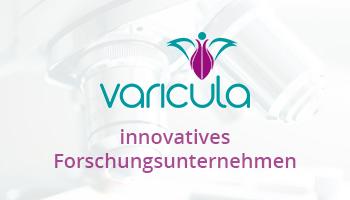 """Eine Werbeanzeige für das Forschungsunternehmen Varicula. Auf ihr ist der Text """"innovatives Forschungsunternehmen"""" zu lesen. Der Hintergrund zeigt das Logo mit der Nahaufnahme von Objektiven eines Mikroskopes."""