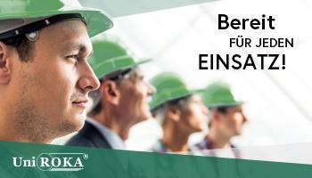 """Eine Werbeanzeige für die Firma UniRoka. Auf ihr ist der Text """"Bereit für jeden Einsatz"""" zu lesen. Der Hintergrund zeigt das Logo mit mehreren Arbeitern, die entschlossen in eine Richtung gucken."""